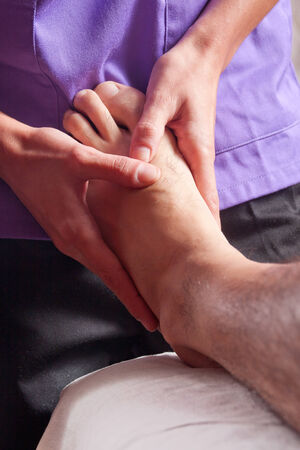 a man is receiving a massage in a foot photo