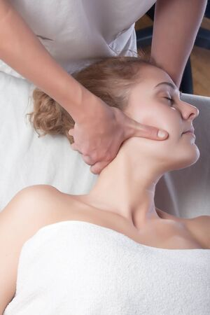 osteopath technique in the neck of a patient Stock Photo