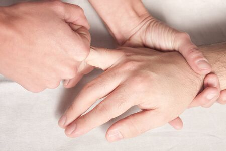 osteopathic procedure in the hand photo