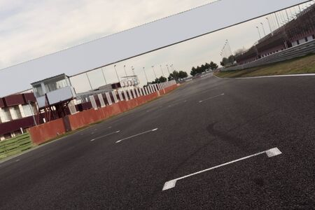 a racetrack with an empty board, for filling with text o logo. It can be used as conceptual business picture. Focus is on the position line Stock Photo