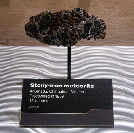 planetoid: DENVER, UNATED STATES - JUNE 4: small stony-iron meteorite fallen in mexico and discovered in 1909, is exposed in the museum of nature and science of Denver, Unted States. Exhibition in Denver June 4, 2015