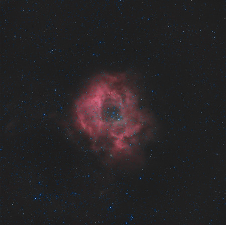 hidrógeno: Una nube de hidrógeno circular en la región de Monoceros de la Vía Láctea. Foto de archivo