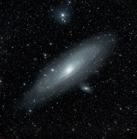 milkyway: Real astronomical picture taken with telescope of the famous Andromeda�s galaxy M31 and its two small satellite-galaxies. Located at 2.5 million light years, it�s very similar to our own galaxy