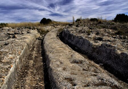 Castellar de meca is an archaeological site of the ibers in Albacete, Spain. The most significant ruins are the carriage roads in the rock, cisterns, and silos