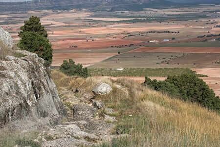 calcareous: Road with the marks excavated in the rock by old carriage wheels. It´s the way to visit castellar de meca iberic ruins in albacete, Spain, an ancient town destroyed by the romans Stock Photo