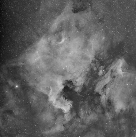 Real astronomic picture taken with telescope of northamerica and pelican nebulas, in infrared exposure