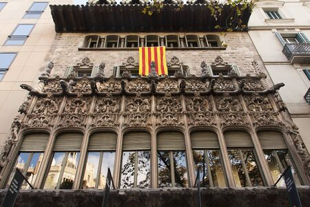 BARCELONA, SPAIN-OCTOBER 12,2017: senyera flag exhibited in Ramon Llull Institute, in diagonal street. Barcelona