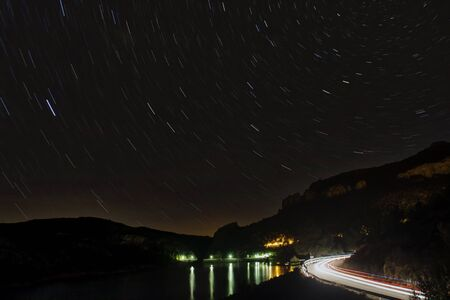 star trails in a night view in the mountains Standard-Bild
