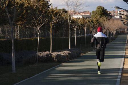 a man running in an urban area