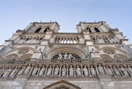 majestic facade of notre dame in paris Standard-Bild - 119985853