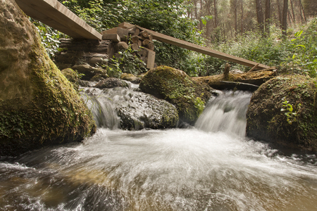 small waterfalls with gangways over it