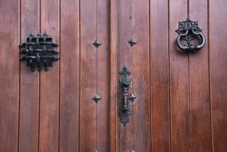 a traditional door with knocker and protected window Standard-Bild