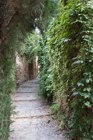 a narrow empty alley in vilafames, an ancient and picturesque village in castellon, spain