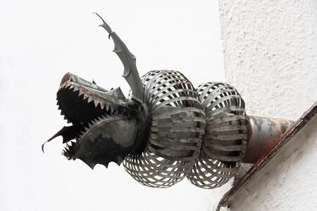 a modern gargoyle with dragon shape