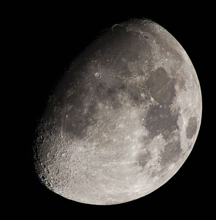 high resolution picture of the moon by telescope, with the moon illuminated at 75% Standard-Bild
