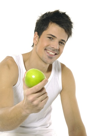 young man holds green apple