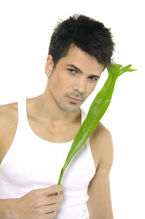 The man holding green leaf