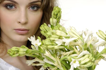 Close up attractive woman with orchid Stock Photo