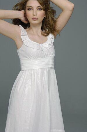 Beautiful female fashion model posing-isolated on gray Stock Photo