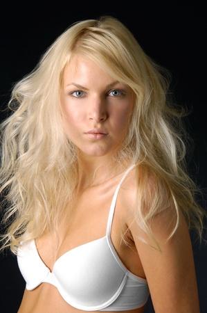 Sexy underwear model on black photo