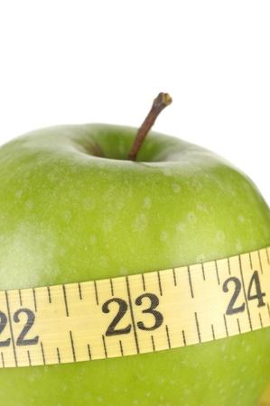 Apple tighten with measure tape photo
