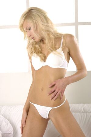 sexy girl wearing white lingerie posing photo