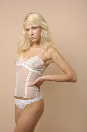 sexy girl wearing white lingerie posing Stock Photo - 11308428