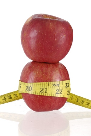 Stacked Red apples with measure tape Stock Photo