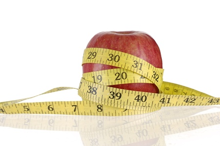 an apple with a measuring tape around it.