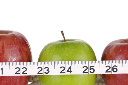 Red and green apples measured the meter, sports apples