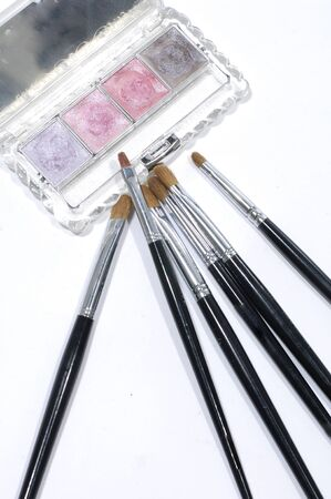 Palettes and brushes on white Stock Photo