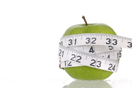Border of apple and measuring tape Stock Photo