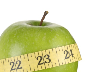 Close up green apples measured the meter