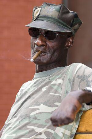fatigues: Disabled Vietnam veteran relaxing in Boulder, Colorado. Stock Photo