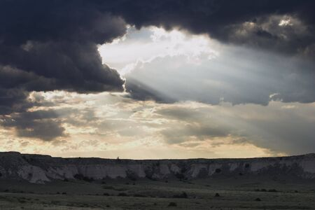 pawnee grassland: Crepuscular rays light up the bluffs of Pawnee National Grassland in Colorado.