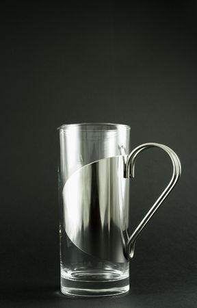 Stylish Irish coffee glass made in Denmark.   Isolated on matte black background. Imagens