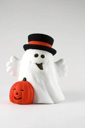 Halloween ghost isolated on textured black background. white. photo