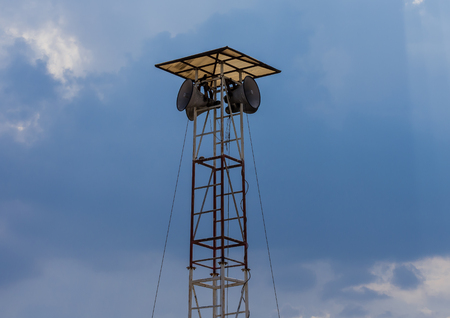 Red and white metal Speaker tower and four speakers with roof. Stock Photo