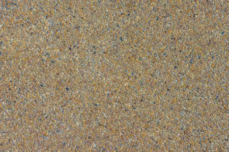 Pequeña piedra de la arena de la textura de la pared de la arena o del fondo de la pared de la arena. textura de fondo flor lavar la grava, lavar la piedra Foto de archivo - 78593760