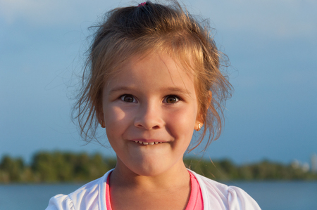 Little girl on the beach, portrait, surprise, joy, admiration, happiness, childhood Stock Photo