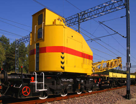 dragline: Train crane carriage. Special railway wagon. Transportation and industry concept. Stock Photo