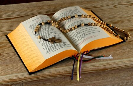 christian altar: Breviary book in Polish and the holy Rosary. Religion concept.