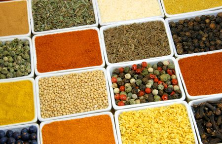 Colorful spices in rectangular ceramic containers - beautiful kitchen image. Stock Photo - 2660292