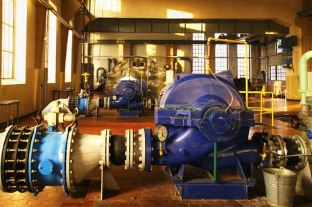 Water pumping station - industrial interior and pipes. Stock Photo