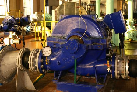 pumping: Water pumping station - industrial interior and pipes. Stock Photo