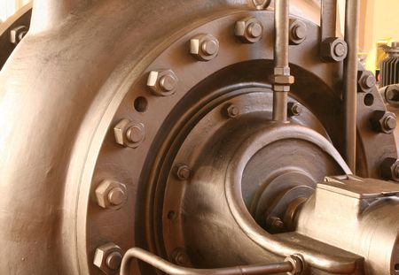 antique factory: Heavy pumping machinery - vintage industrial detail. Retro factory. Stock Photo