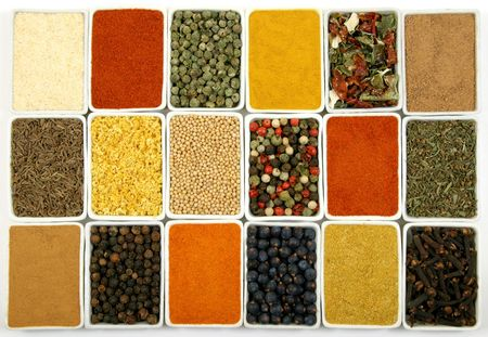 Colorful spices in rectangular ceramic containers - beautiful kitchen image.