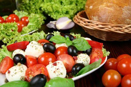 caprese: Caprese - Italian salad with cherry tomatos, olives and mozarella cheese Stock Photo