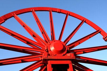 shaft: Vintage mine shaft pulley wheel. Industrial detail.
