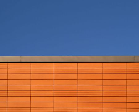 Terracotta tile texture. Abstract background. Orange color and lines. Blue sky. photo